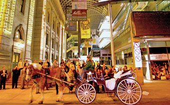 Denver performing arts complex with horse drawn carriage