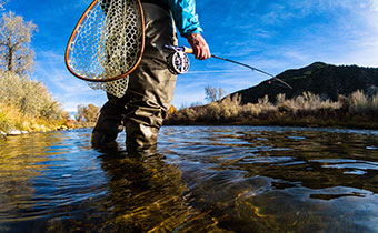 man fly fishing with net